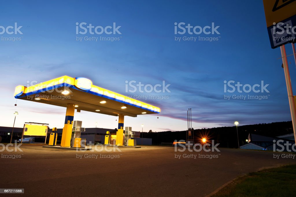 Deserted Gas Station at Night stock photo