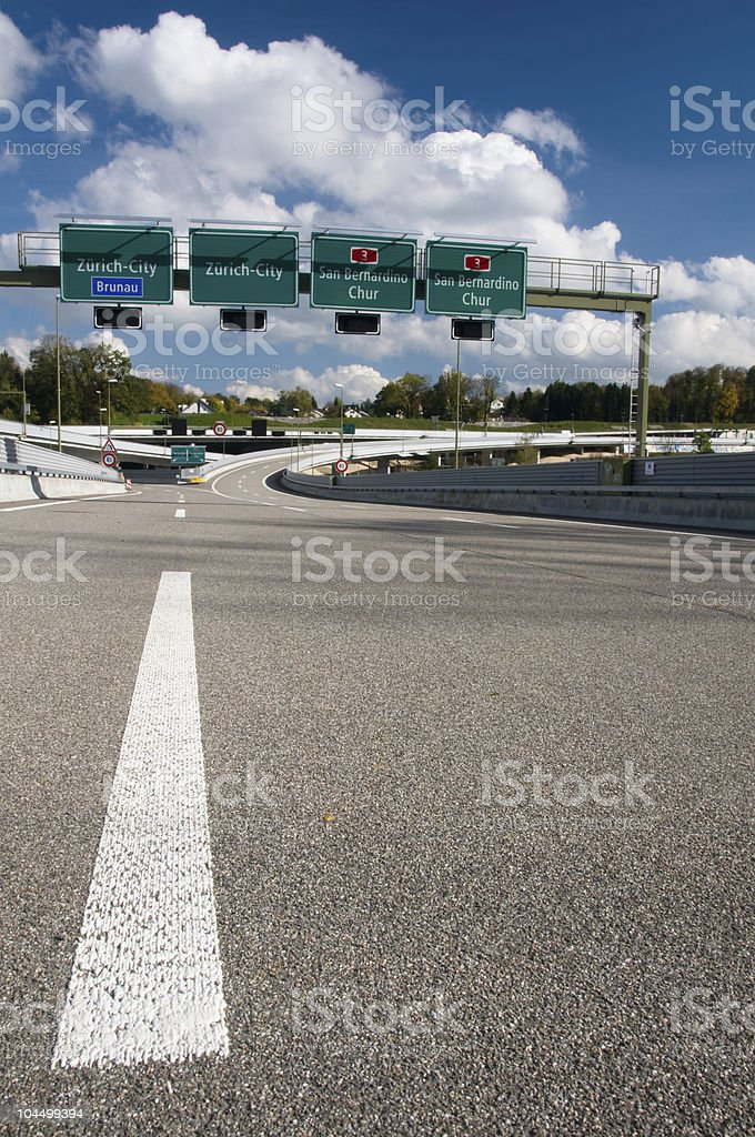 Deserted motorway with signs to Zurich royalty-free stock photo