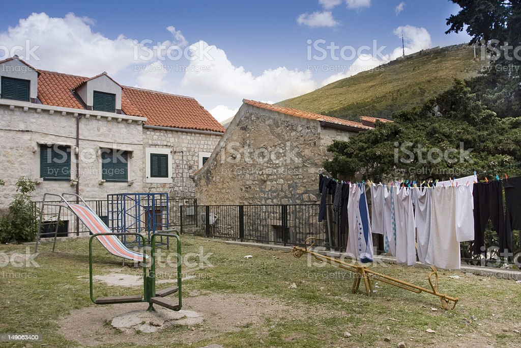 deserted old playground and hung laundry in  dubrovnik royalty-free stock photo