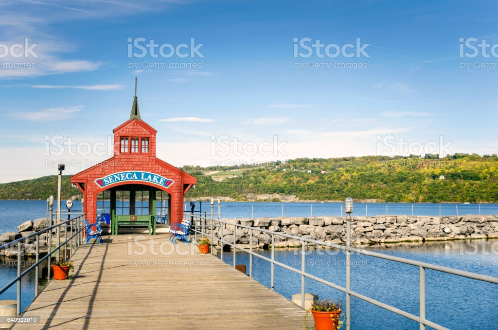 Deserted Pier on a Lake on a Sunny Fall Day stock photo