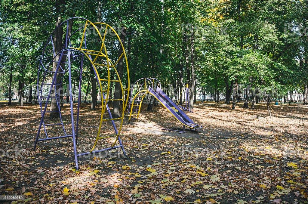Deserted Playground in autumn Park stock photo