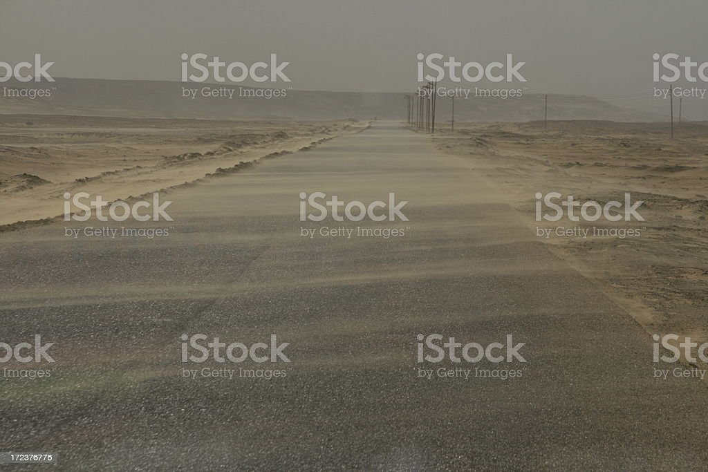 Deserted road in a sandstorm royalty-free stock photo