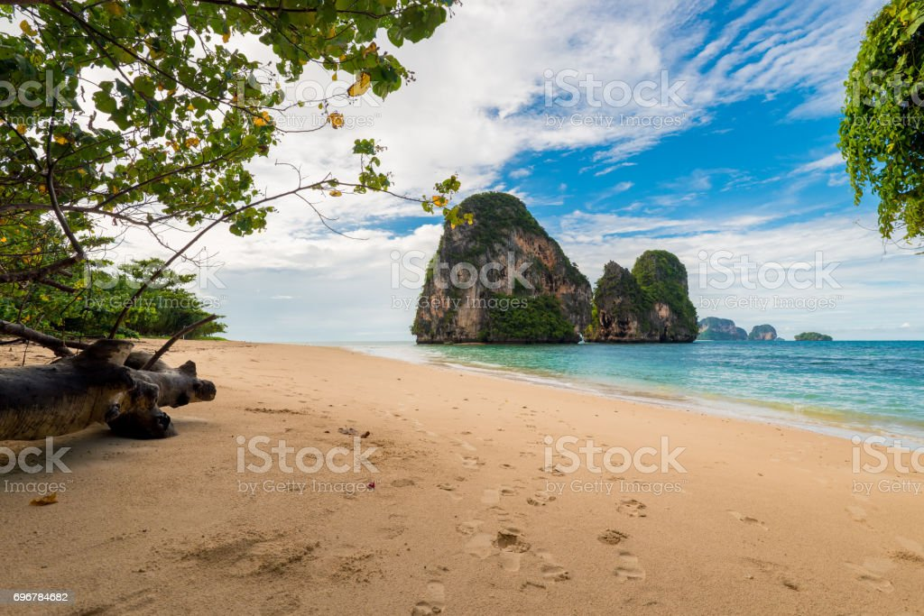 A deserted sandy beach and a beautiful cliff in the Sea, Thailand stock photo