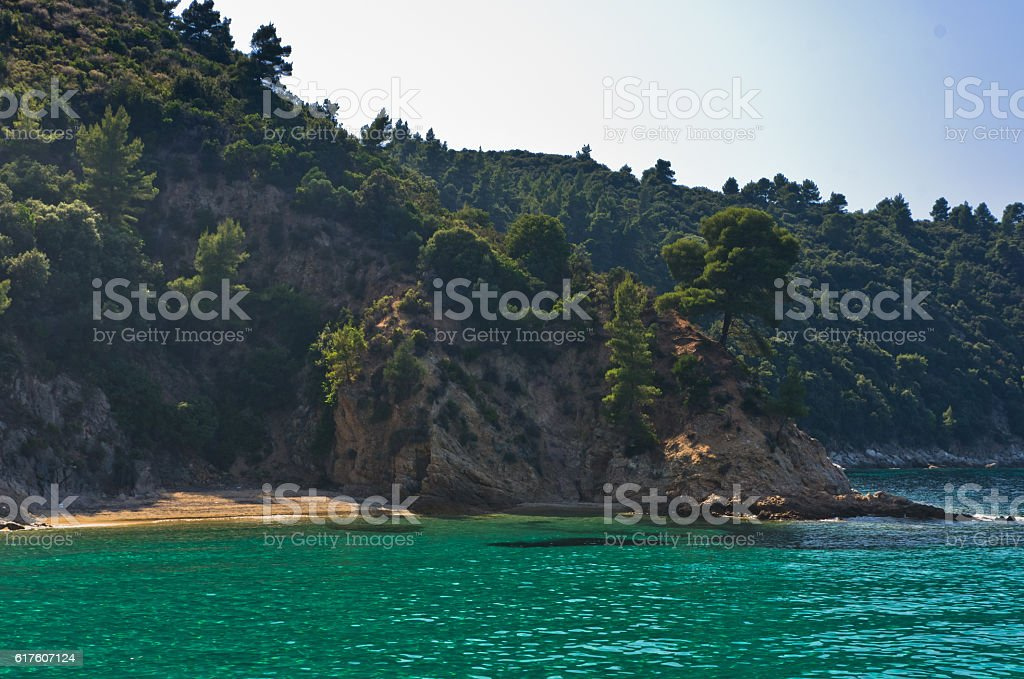 Deserted sandy beach with emerald green water in Sithonia stock photo