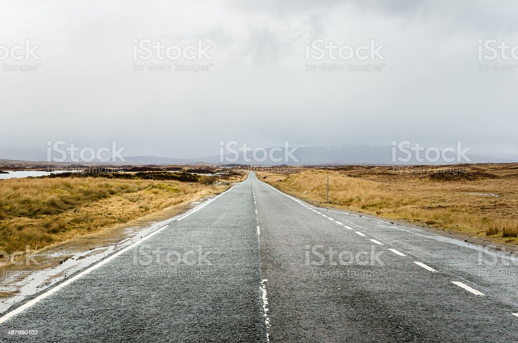 Deserted Straight Road on a Rainy Day stock photo