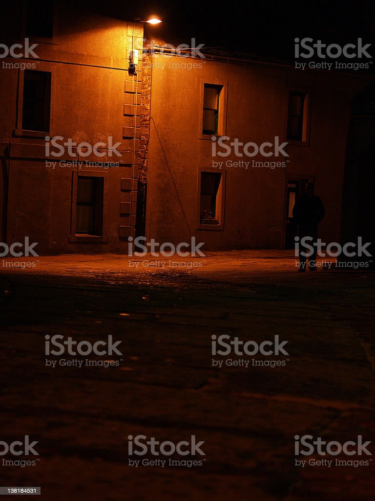 Deserted streets in the evening with a street lamp stock photo