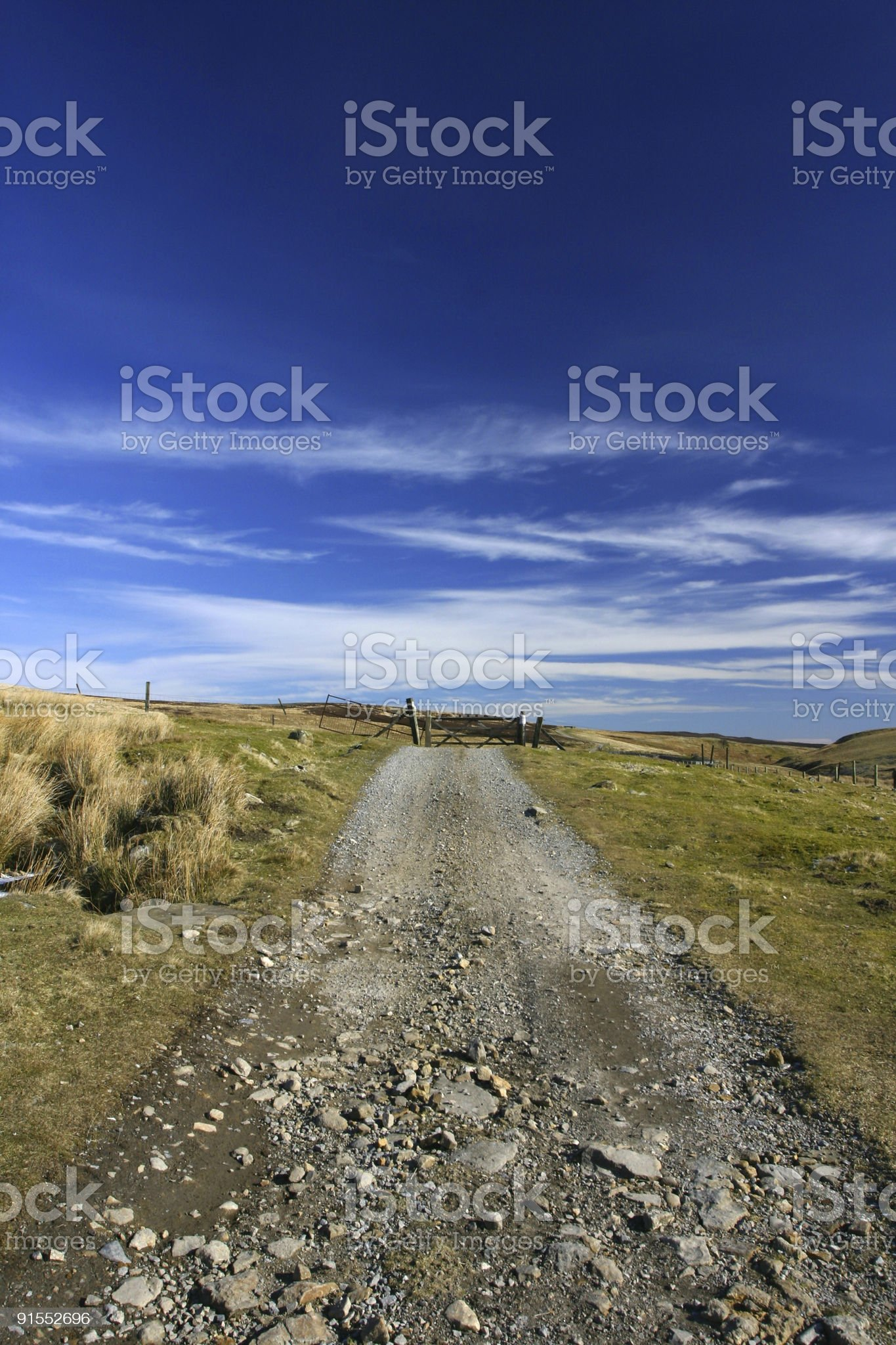 deserted track and gate with blue sky royalty-free stock photo
