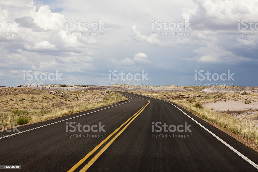 Deserted Two-Lane Road in Desert royalty-free stock photo