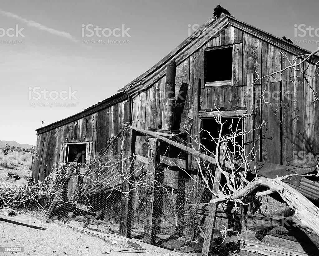 Deserted wooden home in desert (Black & White) royalty-free stock photo