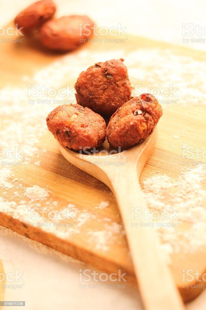 Desi Indian snack tikki/cutlet kept on wooden spoon, selective f stock photo