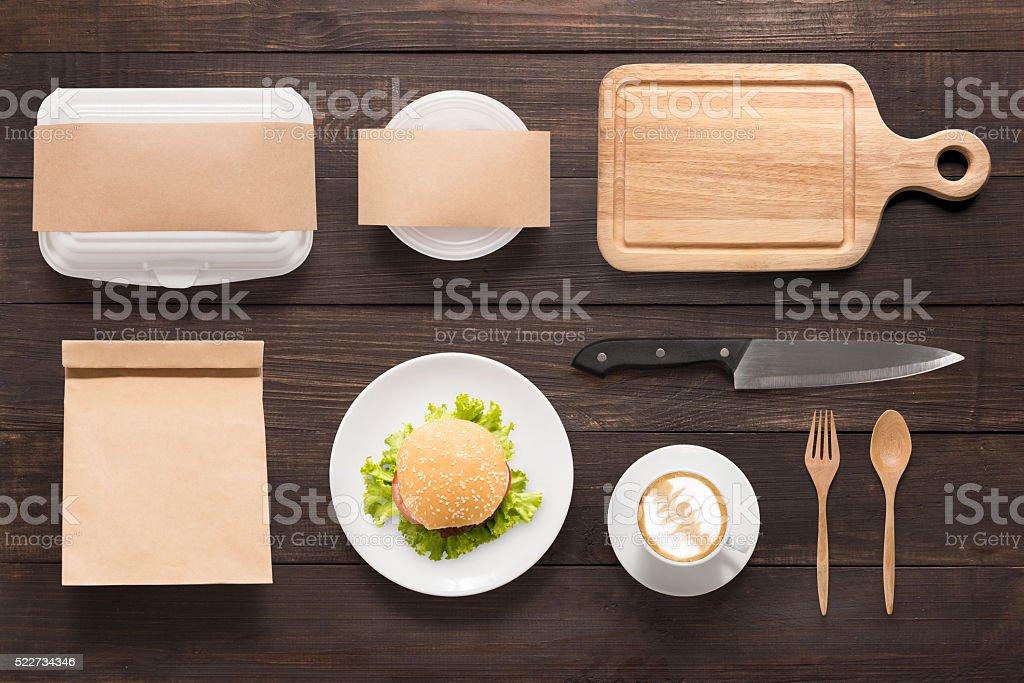 Design concept  brand of mockup burger set on wooden background. stock photo