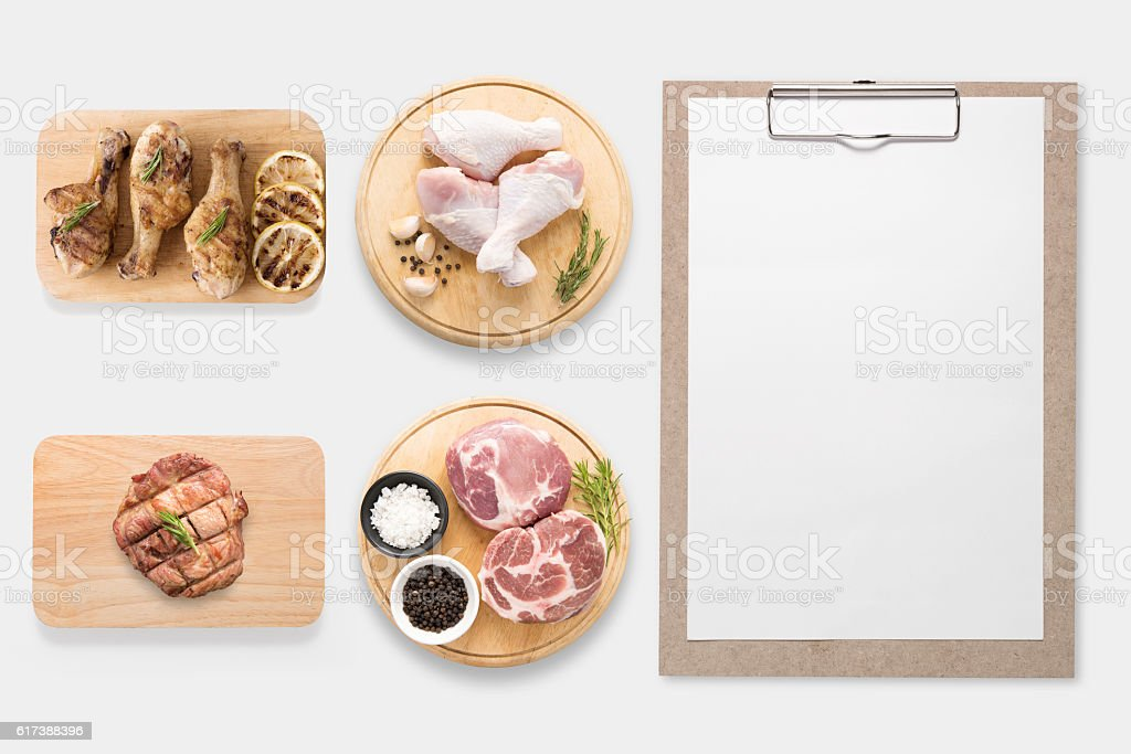 Design concept of mockup clipboard and pork, chicken drumstick. stock photo