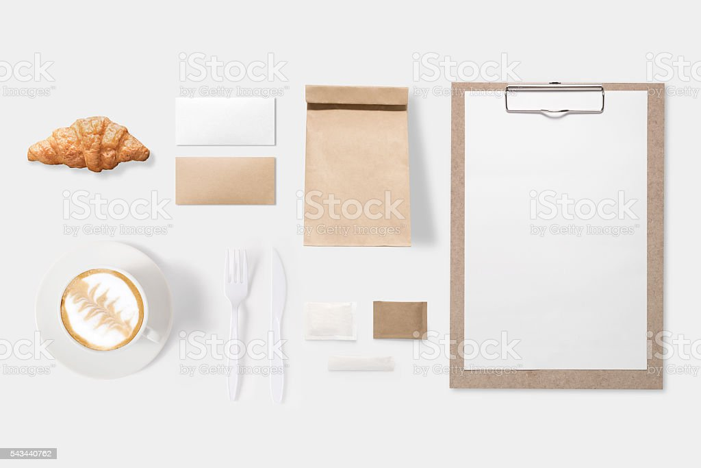 Design concept of mockup paper, bag, clipboard and coffee cup stock photo