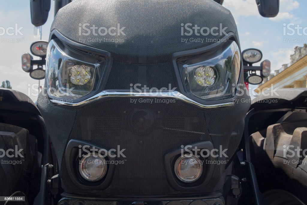 Design of a modern tractor close-up. Industry stock photo