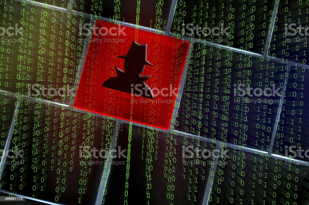 Design of hacker emblem upon a keyboard in front of code stock photo