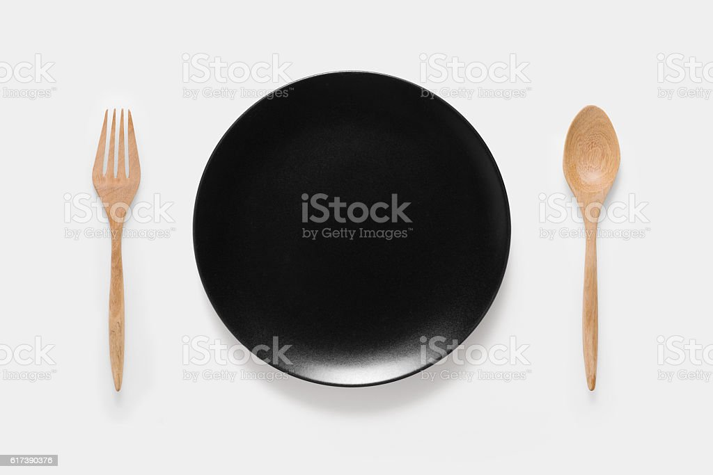 Design of mockup black dish, wood spoon and wood fork. stock photo