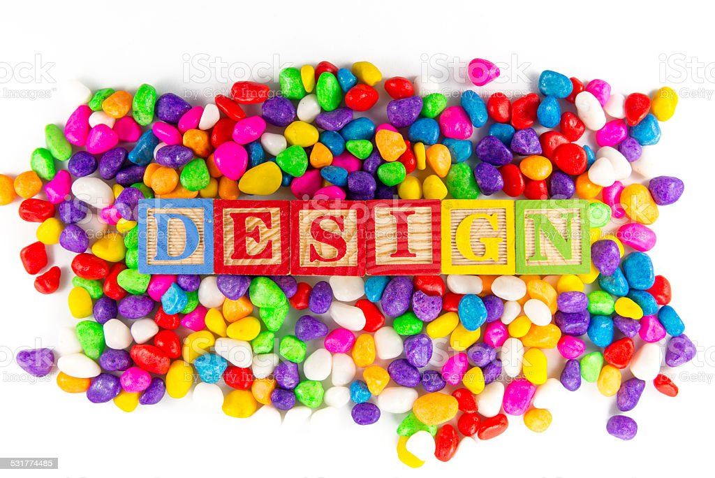 design word in colorful stone stock photo