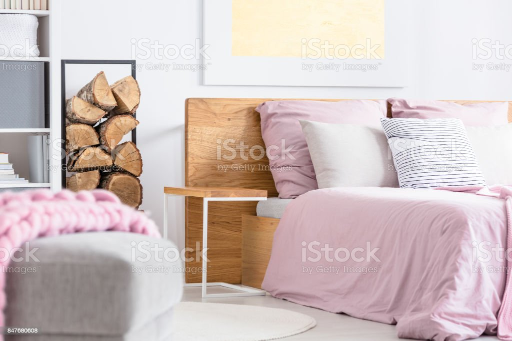 Designed table next to the bed stock photo
