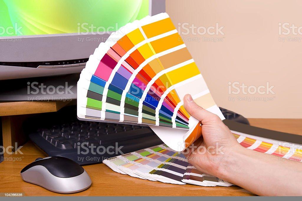 Designer artist holding a color palette royalty-free stock photo