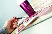 Designer choosing color samples for design project.