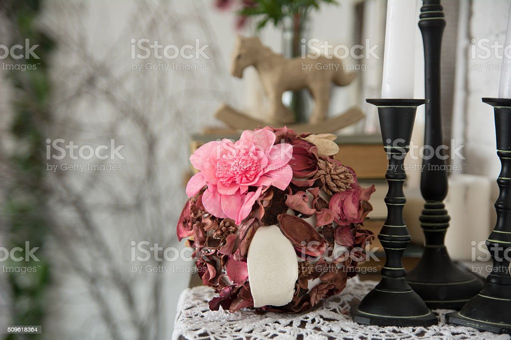 Designer composition with artificial and dried flowers. stock photo