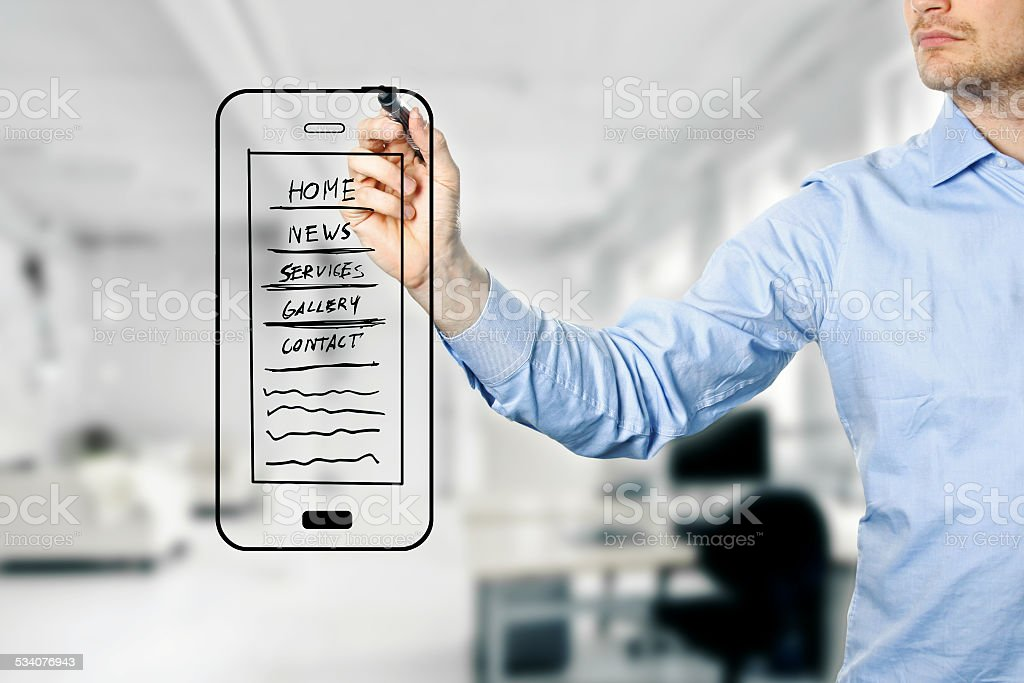 designer drawing mobile website development wireframe stock photo