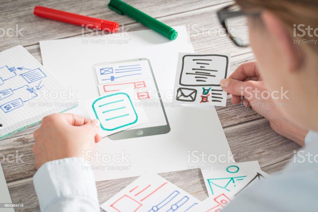Designer drawing website ux app development. stock photo