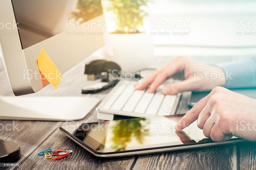 Designer hand working with digital tablet. stock photo