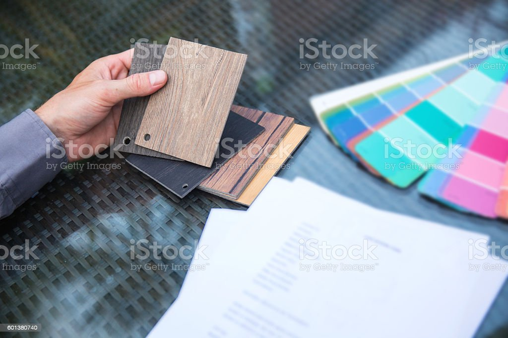 Designer holding timber wood samples stock photo