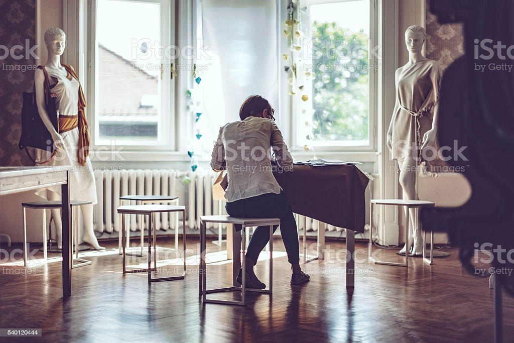 Designer in her showroom stock photo