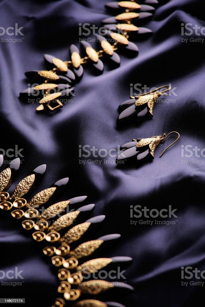 Designer jewelry on a satin royalty-free stock photo