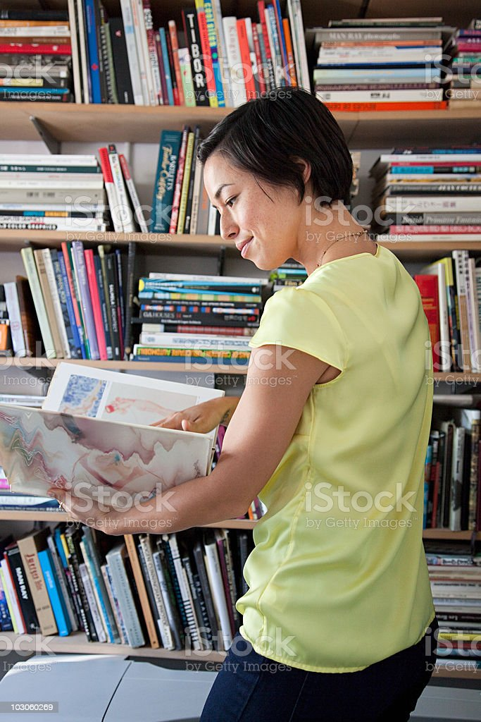 Designer looking at book stock photo