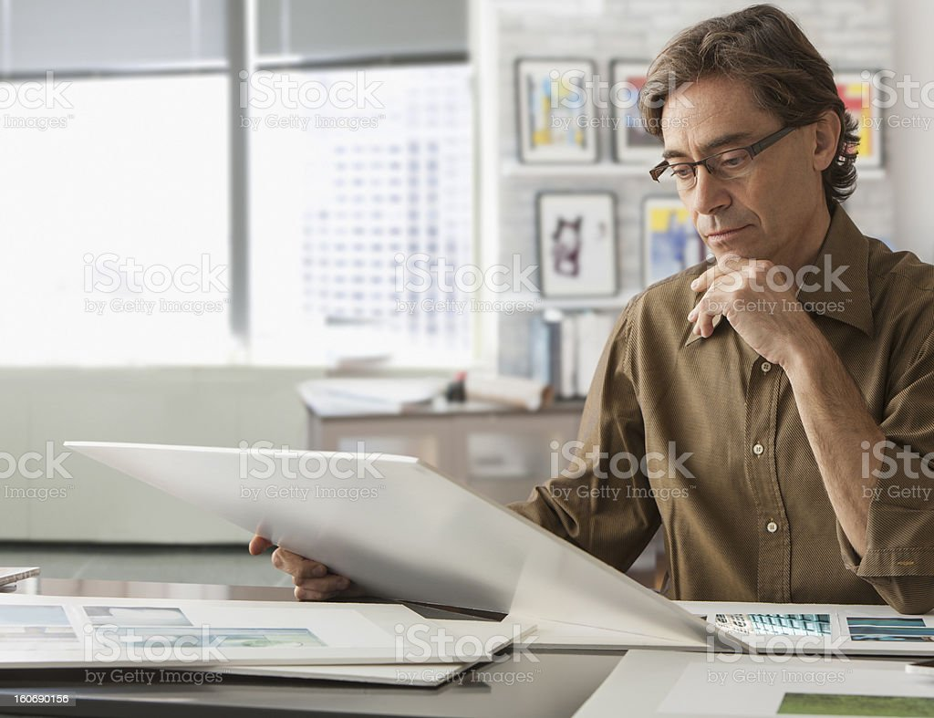 Designer looking at his work royalty-free stock photo