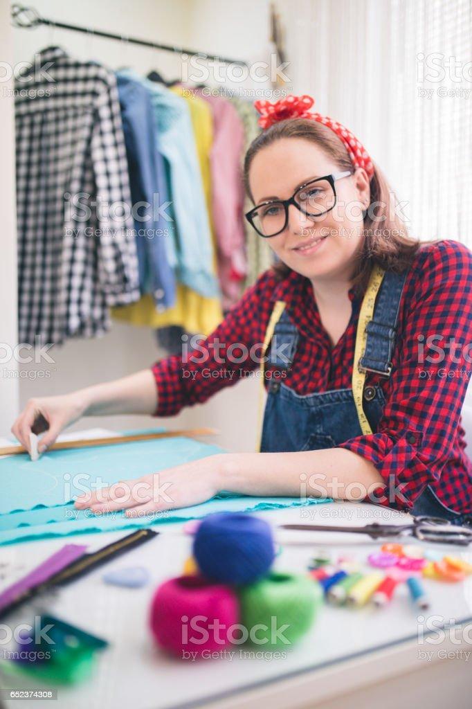 Designer measuring textile material stock photo