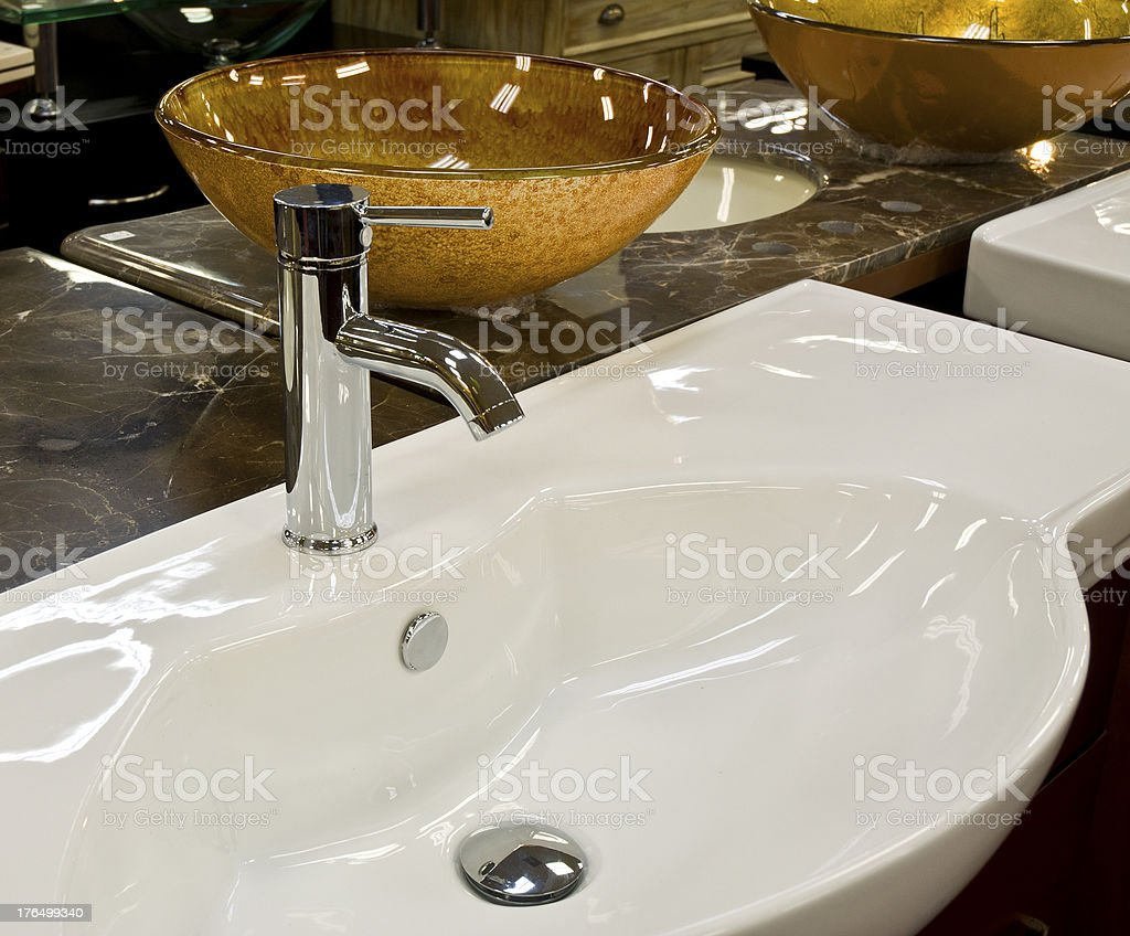 Designer Porcelin Sink Faucet And Glass Basin In Retail Showroom stock photo