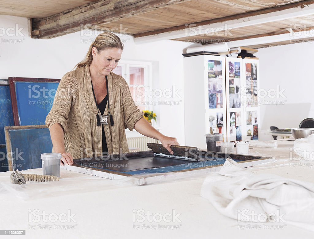 Designer printing on textiles in studio stock photo