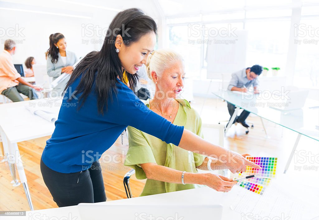 Designer Suggesting in which Color from the Color Swatch stock photo