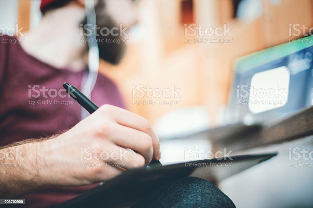 Designer using digital drawing tablet at studio. stock photo