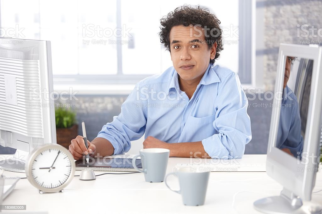 Designer using digital tablet royalty-free stock photo