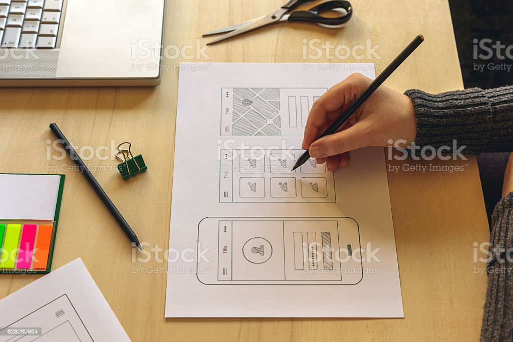 Designer wireframing a mobile App stock photo