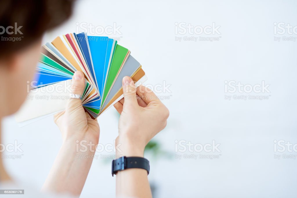 Designer with color swatch stock photo