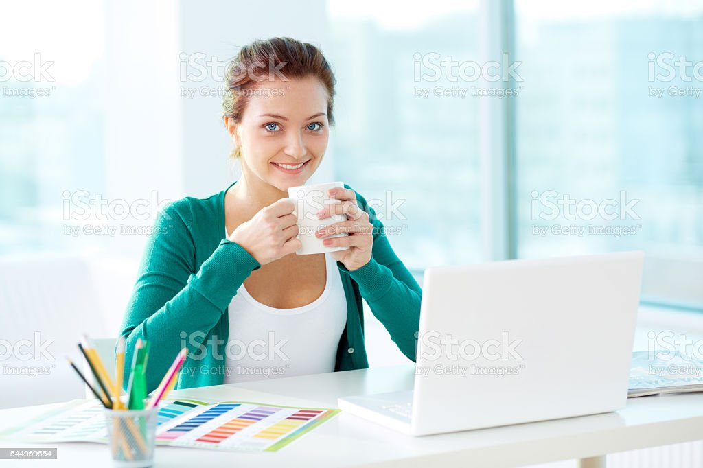 Designer with cup stock photo