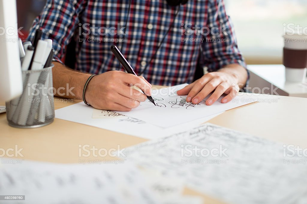 Designer working and drawing letters stock photo