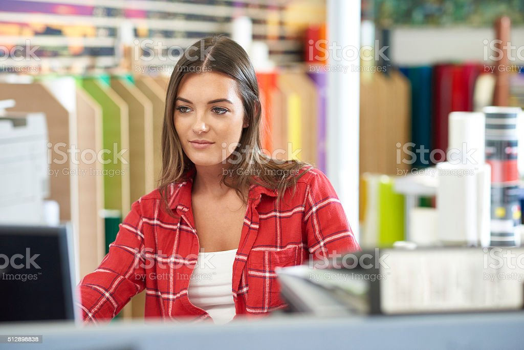 designer working at a graphics shop stock photo