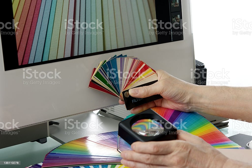 Designer working hard in front of PC monitor royalty-free stock photo