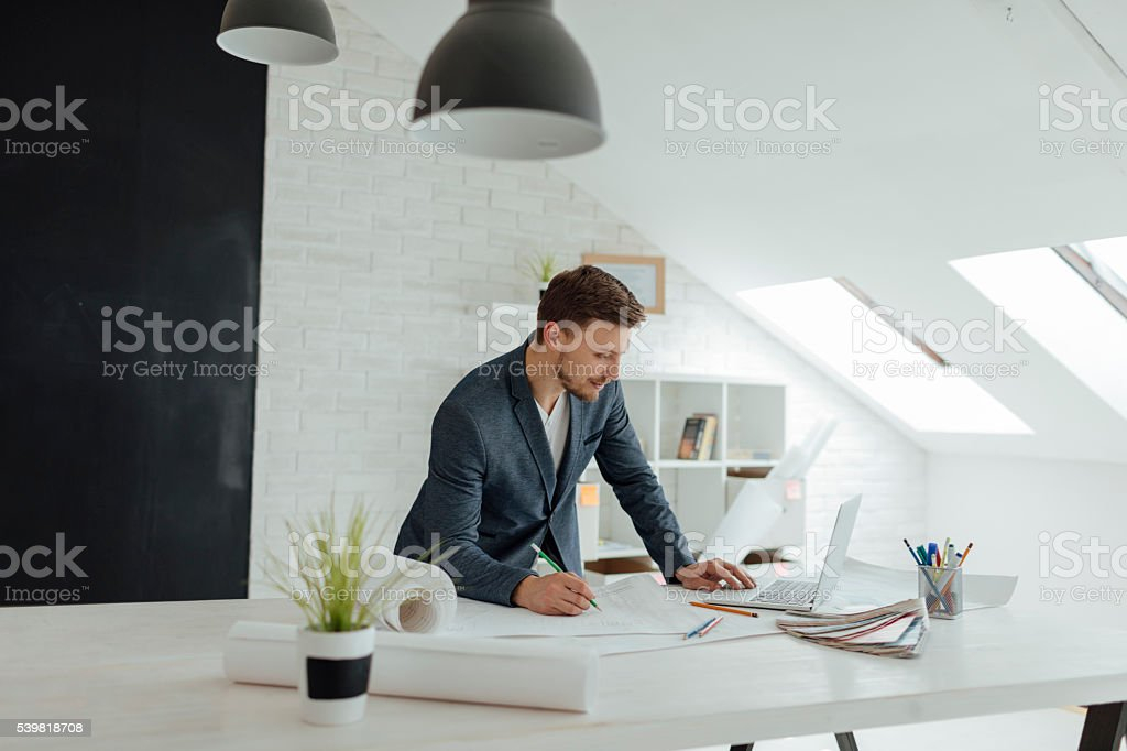 Designer Working In His New Office. stock photo