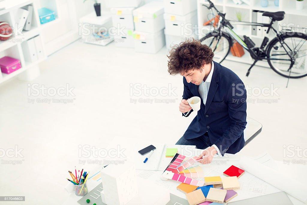 Designer working in office. stock photo