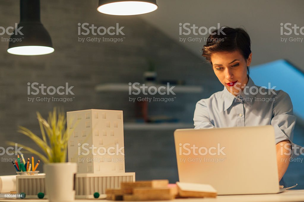 Designer Working Late In Her Office. stock photo