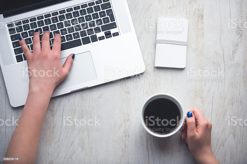Designer working on laptop in studio stock photo