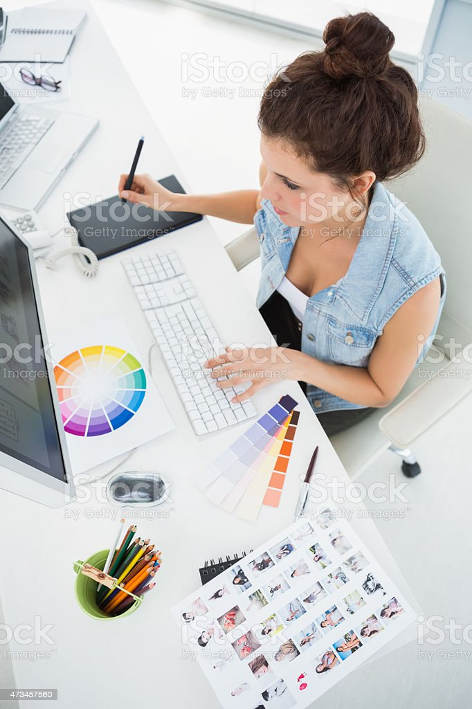 Designer working with colour wheel and digitizer stock photo